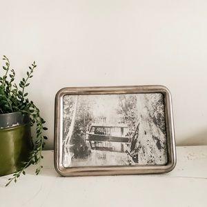 Vintage black and white print in metal frame